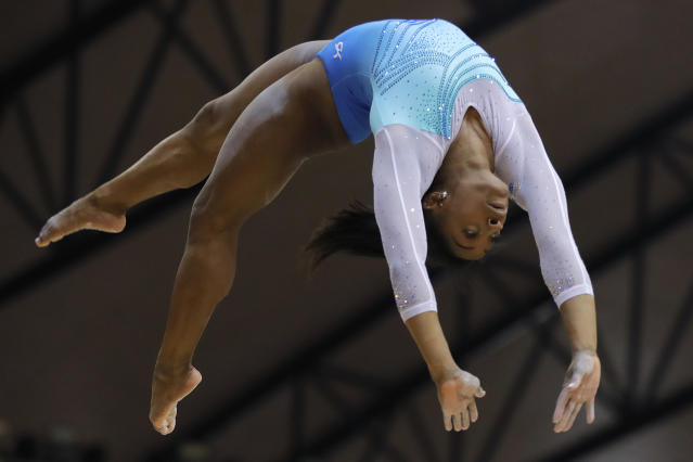 FILE - In this Nov. 1, 2018, file photo, Simone Biles performs on the balance beam during the Women's All-Around Final of the Gymnastics World Chamionships at the Aspire Dome in Doha, Qatar. With the Olympics a year away, the world's best gymnast believes there's always a new wrinkle, twist or turn to be added to her routine to stay ahead of her competitors. Biles will face some of American challengers in this weekend's GK US Classic, a prelude to next month's Nationals. (AP Photo/Vadim Ghirda, File)