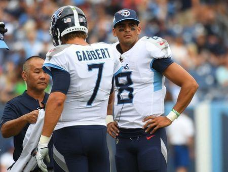 Sep 16, 2018; Nashville, TN, USA; Tennessee Titans quarterback Marcus Mariota (8) and Tennessee Titans quarterback Blaine Gabbert (7) in a huddle during the first half against the Houston Texans at Nissan Stadium. Mandatory Credit: Christopher Hanewinckel-USA TODAY Sports