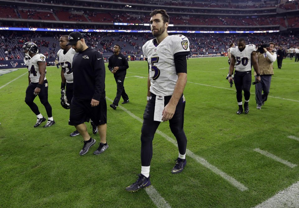 Baltimore Ravens quarterback Joe Flacco (5) leaves the field after his team lost to the Houston Texans, 25-13 at an NFL football game Sunday, Dec. 21, 2014, in Houston. (AP Photo/David J. Phillip)
