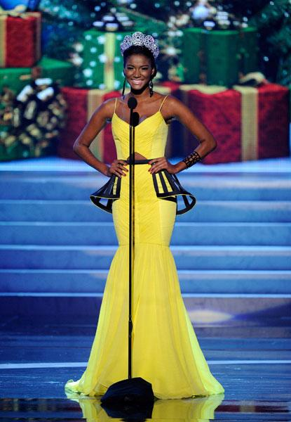 <b>Miss Universe 2012 </b><br><br>Miss Angola Leila-Lopes, the winner of Miss Universe 2011, looks stunning in yellow as she makes a speech at the pageant.<br><br>© Getty