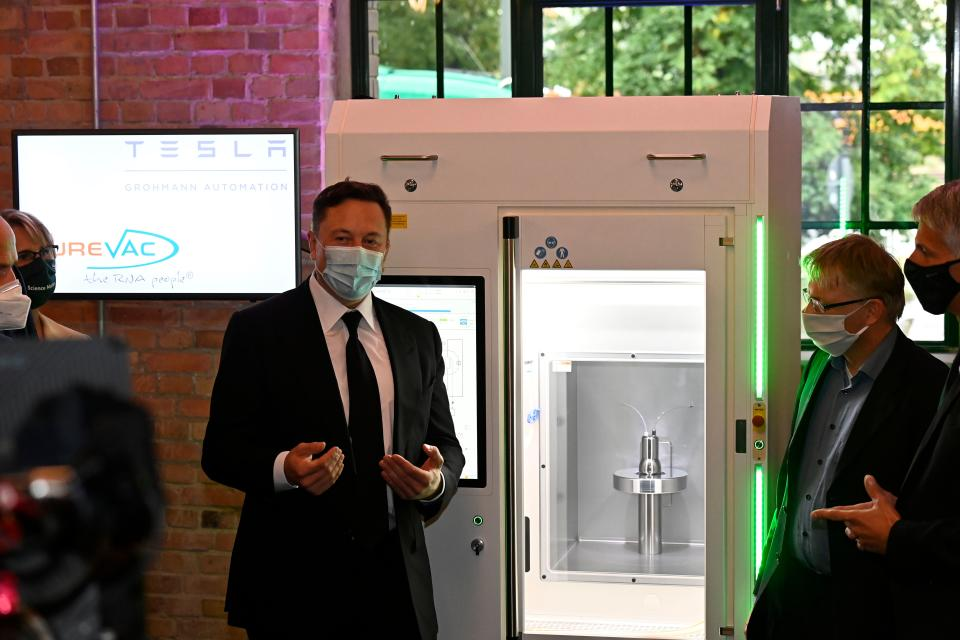 Futurist entrepreneur Elon Musk presents a RNA printer, essentially a vaccine production device, on the sidelines of a meeting with the leadership of the conservative CDU/CSU parliamentary group in Berlin on September 2, 2020. - The RNA printer is jointly developped by biopharmaceutical company CureVac and Tesla Grohmann Automation, a world-leader in highly automated methods of manufacturing. (Photo by Tobias SCHWARZ / various sources / AFP) (Photo by TOBIAS SCHWARZ/POOL/AFP via Getty Images)