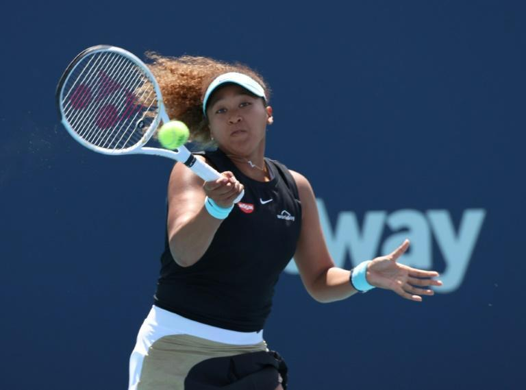 Naomi Osaka reached the last 16 for the first time after a walkover against Nina Stojanovic