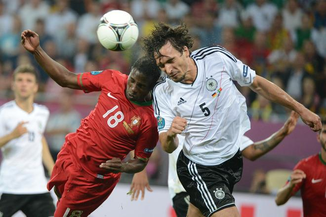 German defender Mats Hummels (R) vies with Portuguese forward Silvestre Varela during the Euro 2012 championships football match Germany vs Portugal  on June 9, 2012 at the Arena Lviv.   AFP PHOTO / DAMIEN MEYERDAMIEN MEYER/AFP/GettyImages