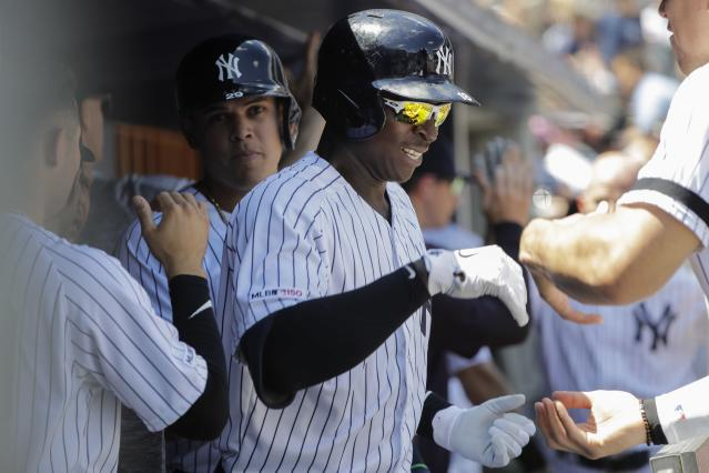 New York Yankees' Didi Gregorius celebrates with teammates after hitting a three-run home run during the first inning of a baseball game against the Baltimore Orioles in the first game of a doubleheader Monday, Aug. 12, 2019, in New York. (AP Photo/Frank Franklin II)