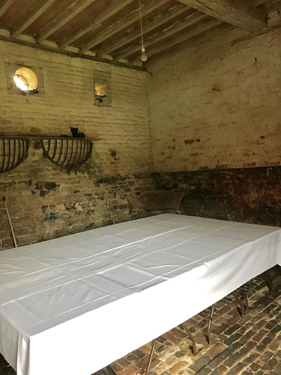 """An empty stable barn, ready to be transformed into this evening's """"Dinner in a Manger."""""""