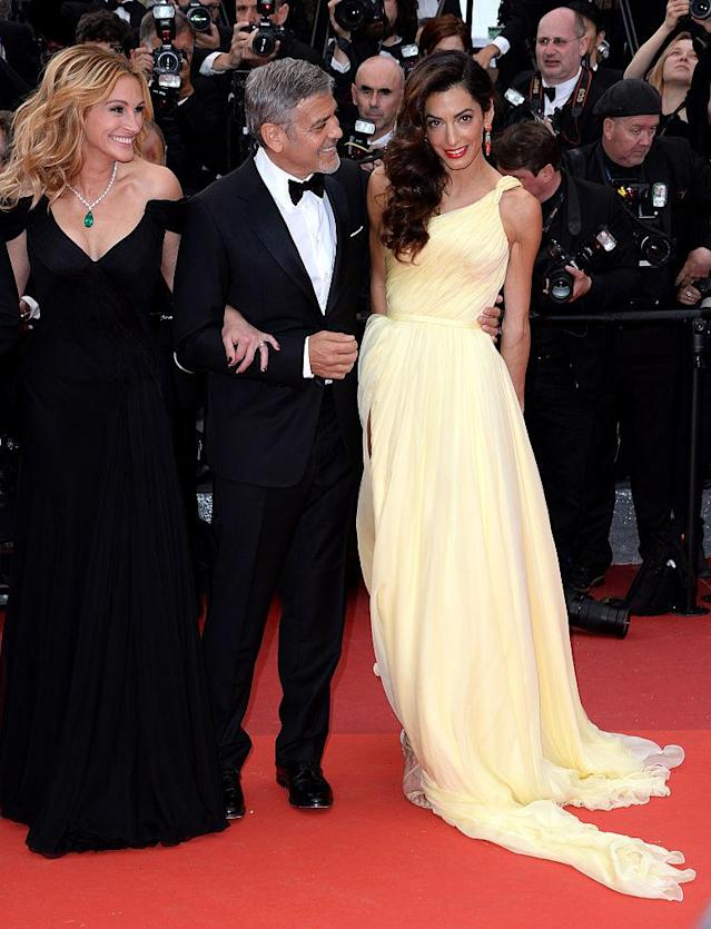 Julia Roberts, George Clooney, and Amal Clooney attend the <em>Money Monster</em> premiere at the 69th annual Cannes Film Festival on May 12, 2016. (Photo: Anthony Harvey/FilmMagic)