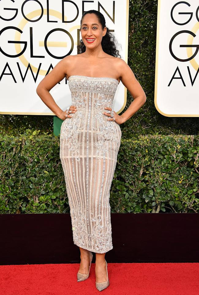 <p>Tracee Ellis Ross wearing a silver strapless beaded couture midi dress with an underlying corsetry. (Photo: Getty Images) </p>