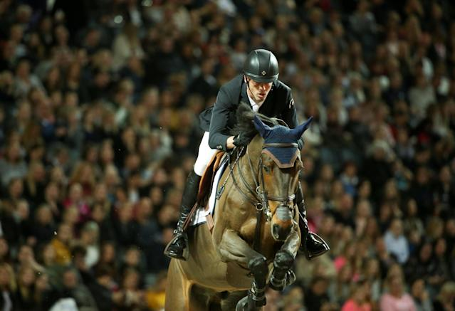 Equestrian - Sweden International Horse Show - International jumping - Qualification for Sweden Masters - Friends Arena, Stockholm, Sweden - December 1, 2017. Harrie Smolders of Nederlands on his horse Cas 2 jumps. TT News Agency/Soren Andersson/via REUTERS ATTENTION EDITORS - THIS IMAGE WAS PROVIDED BY A THIRD PARTY. SWEDEN OUT. NO COMMERCIAL OR EDITORIAL SALES IN SWEDEN