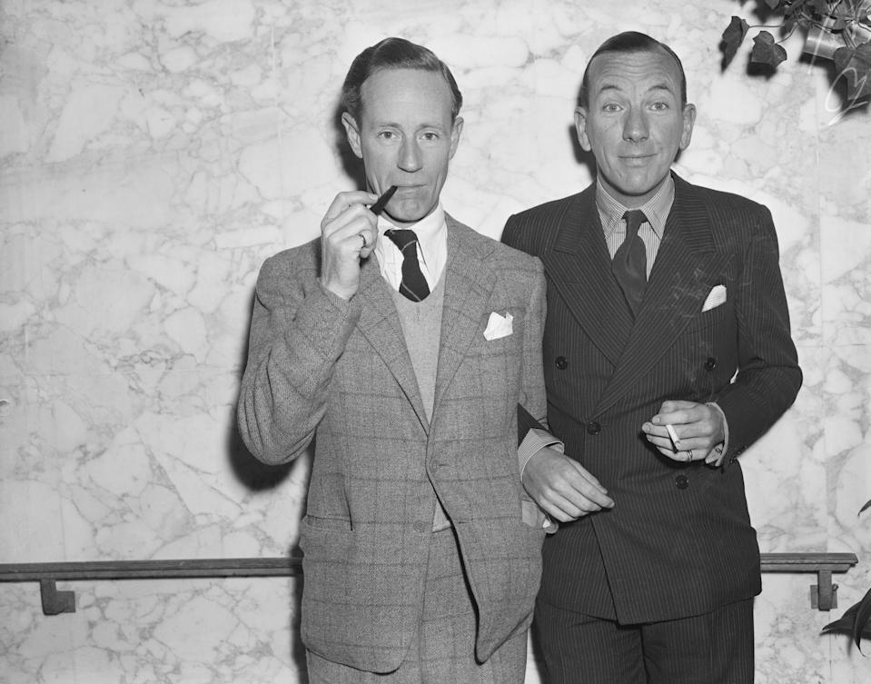 (Original Caption) 11/10/1938-New York, NY: Leslie Howard, too well knwon to American movie fans to need an introduction, is pictured with another famous Englishman, Noel Coward, actor, author, playwright, as they arrived today on the S.S. Normandie. Actor Howard plans to leave almost immediately for Hollywood.