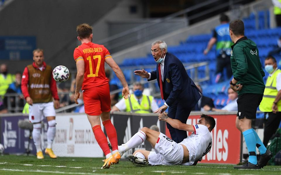 Edoardo Reja Head Coach of Albania is knocked to the ground by Rey Manaj of Albania during the International Friendly Match between Wales and Albania at the Cardiff City Stadium on June 5, 2021 in Cardiff, Wales. - GETTY IMAGES