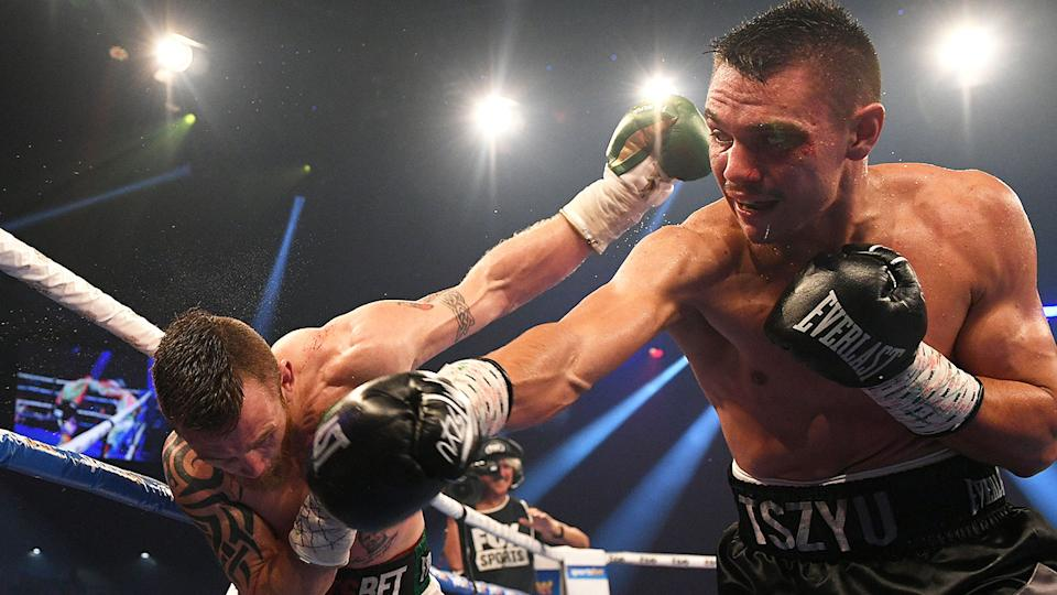 Seen here, Tim Tszyu hits Dennis Hogan with a powerful right hand.