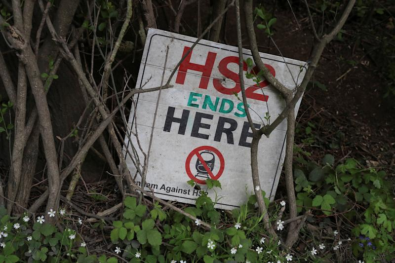 A placard for Stop HS2 campaign sits at the bottom of a tree at a development site for the High Speed 2 rail in Harefield, Britain April 28, 2019. REUTERS/Simon Dawson