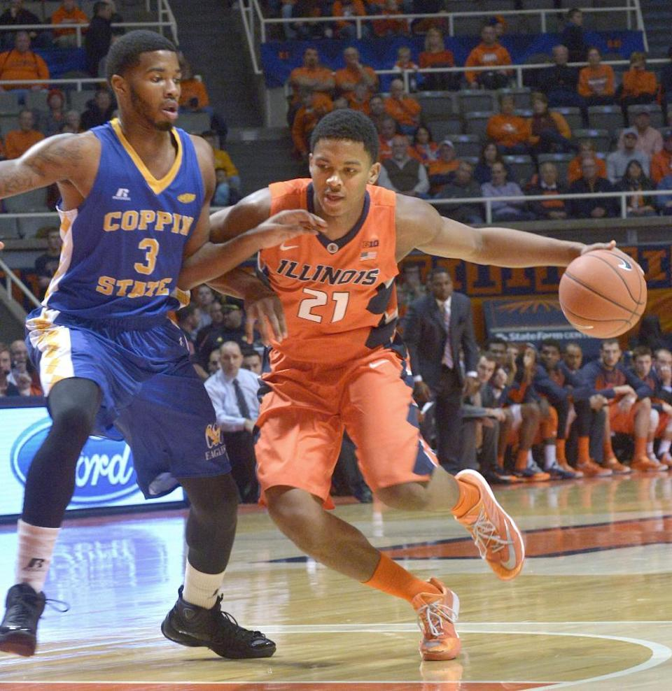 Illinois' guard Malcolm Hill (21) drives past Coppin State's forward Arnold Fripp (3) during an NCAA college basketball game in Champaign, ILL on Sunday, Nov. 16, 2014. (AP Photo/Robin Scholz)