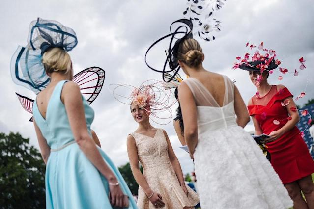 While many come for the racing at the Prix de Diane in Chantilly, north of Paris, plenty of others come simply to see and be seen (AFP Photo/LUCAS BARIOULET)