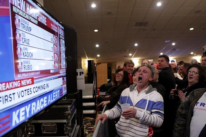 <p>Michael Powlowsky of Hudson, N.H., cheers as a television screen shows early poll numbers favoring Republican presidential candidate Donald Trump at Trump's election night rally on Feb. 9, 2016, in Manchester, N.H. Trump was projected the Republican winner shortly after the polls closed. (Matthew Cavanaugh/Getty Images)</p>