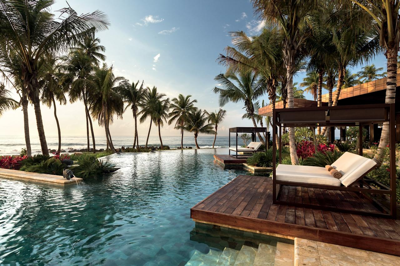 "The emphasis at <a href=""https://www.cntraveler.com/hotels/dorado/dorado/dorado-beach-a-ritz-carlton-reserve?mbid=synd_yahoo_rss"" target=""_blank"">this Ritz-Carlton Reserve</a>—one of four in the world—is on setting. The hotel has undergone many transformations, including after Hurricane Maria in 2017, but ever since Laurance Rockefeller built a sanctuary here it has been all about sea, sand, and lush greenery. Beach-facing terraces and outdoor showers bookend rooms, and museum-grade artwork is scattered on tree branches. But it's the Spa Botánico, a tropical wonderland, that really fits Rockefeller's approach. After visiting, you'll remember the 95-year-old ficus at the entrance most clearly. That, or the treehouse in the canopy where you had the greatest massage of your life."