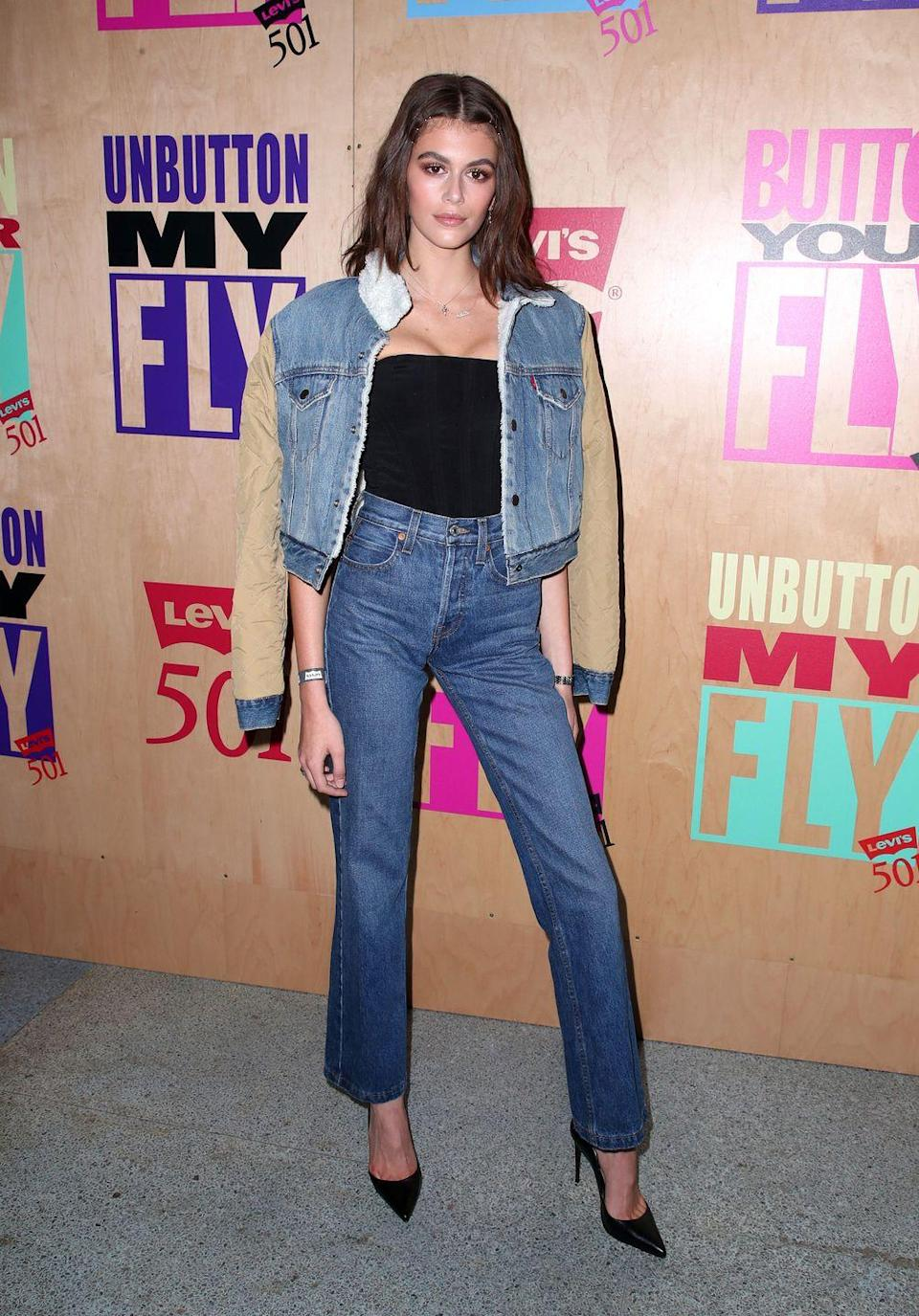 <p>Kaia wore a pair of 501's along with a faded denim jacket with contrasting sleeves and shearling collar for the Levi's 501 Day party in Los Angeles. </p>