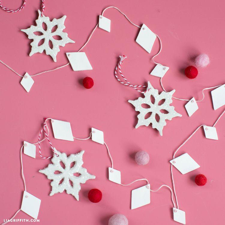 """<p>String this modern holiday garland on your Christmas tree, other house plants, or in a window or a doorway—the options are endless. </p><p><a href=""""https://go.redirectingat.com?id=74968X1596630&url=https%3A%2F%2Fliagriffith.com%2Fclay-geometric-garland%2F&sref=https%3A%2F%2Fwww.oprahdaily.com%2Flife%2Fg37499128%2Fdiy-christmas-garland-ideas%2F"""" rel=""""nofollow noopener"""" target=""""_blank"""" data-ylk=""""slk:Get the tutorial."""" class=""""link rapid-noclick-resp"""">Get the tutorial.</a></p><p><a class=""""link rapid-noclick-resp"""" href=""""https://www.amazon.com/DAS-Hardening-Modeling-Pound-387500/dp/B001GAP4YA?tag=syn-yahoo-20&ascsubtag=%5Bartid%7C10072.g.37499128%5Bsrc%7Cyahoo-us"""" rel=""""nofollow noopener"""" target=""""_blank"""" data-ylk=""""slk:SHOP CLAY"""">SHOP CLAY</a></p>"""