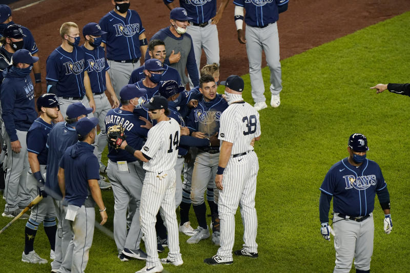 Tampa Bay Rays and New York Yankees exchange words after the Rays' 5-3 loss to the Yankees in a baseball game, Tuesday, Sept. 1, 2020, at Yankee Stadium in New York. Both teams' benches received warnings from the umpires after Yankees relief pitcher Aroldis Chapman threw near the head of pinch-hitter Michael Brosseau during the ninth inning. (AP Photo/Kathy Willens)