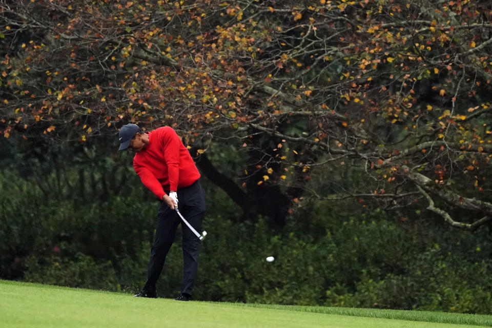 FILE - Tiger Woods hits on the second fairway during the final round of the Masters golf tournament in Augusta, Ga., in this Sunday, Nov. 15, 2020, file photo. Gone are the autumn hues of gold, orange and red in the trees, the brown leaves mixed in with the pine straw on the ground. Augusta National is blazing with pink and red and purple azaleas, accented by the white blooms of dogwood. Postponed last year because of the COVID-19 pandemic, the Masters is back to being that annual rite of spring. (AP Photo/Matt Slocum, File)