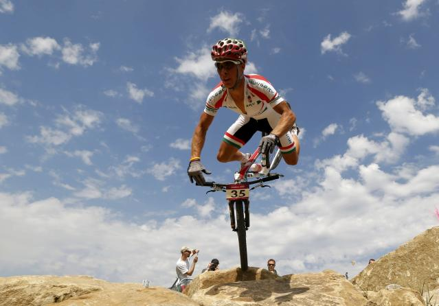 Hungary's Andras Parti reacts as he falls during the men's cross-country mountain bike event at Hadleigh Farm during the London 2012 Olympic Games August 12, 2012. OLY-CYCL-CMMBIK/(CMM021101) REUTERS/Stefano Rellandini (BRITAIN - Tags: OLYMPICS SPORT CYCLING TPX IMAGES OF THE DAY)