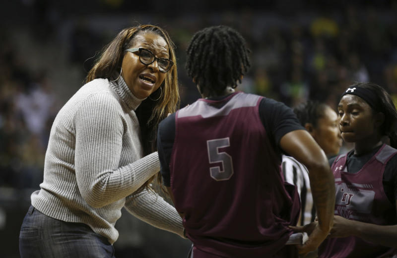 Texas Southern head basketball coach Cynthia Cooper-Dyke, left, talks to her players Ciani Cryor, center, and Jekalen Jones during the second quarter of an NCAA college basketball game against Oregon, in Eugene, Ore., Saturday, Nov. 16, 2019. (AP Photo/Chris Pietsch)