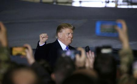 U.S. President Donald Trump pumps his fist at members of the U.S. military as he arrives to address them after his summit meeting with North Korea's Kim Jong Un in Vietnam during a refueling stop at Elmendorf Air Force Base in Anchorage, Alaska, U.S., February 28, 2019. REUTERS/Leah Millis