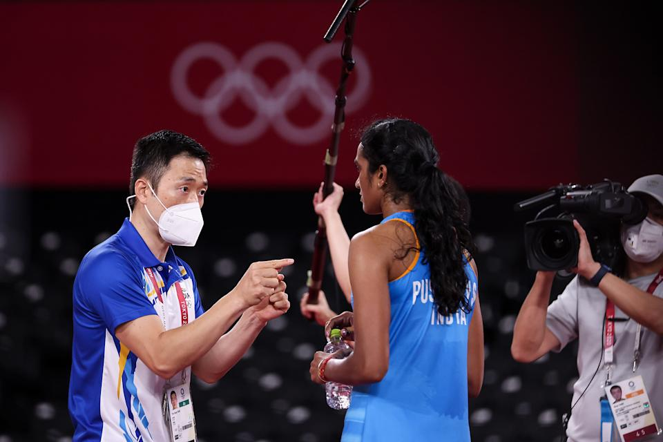 PV Sindhu of Team India talks to her coach Park Tae-Sang