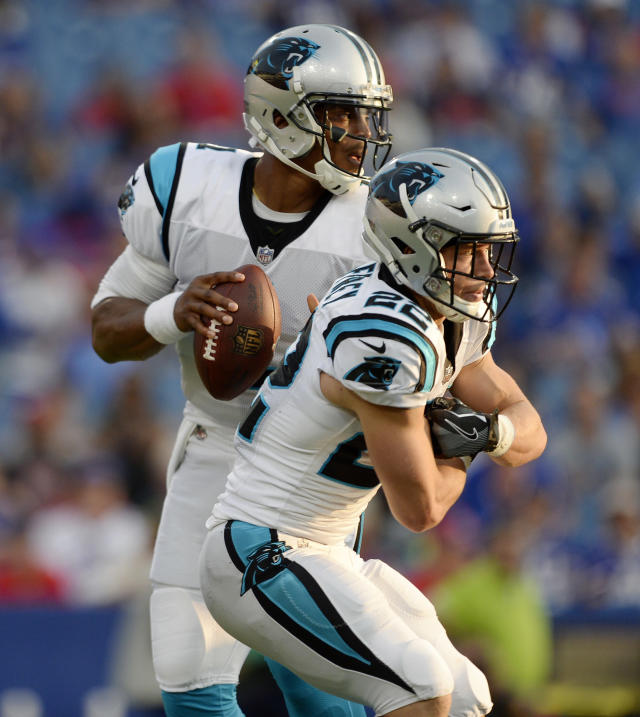 FILE - In this Aug. 9, 2018, file photo,Carolina Panthers quarterback Cam Newton, left, fakes a handoff to running back Christian McCaffrey during the first half of an NFL football game against the Buffalo Bills,in Orchard Park, N.Y. Newton has been the focal point of the Panthers offense for the past seven seasons, but thats about to change _ at least to some degree. Sure, Newton will still be running the show and remain a dual-threat QB, but coach Ron Rivera has made it clear Christian McCaffrey will play a much larger role this season, saying that it would be ideal to get the second-year running back 25 to 30 touches per game. (AP Photo/Adrian Kraus, File)