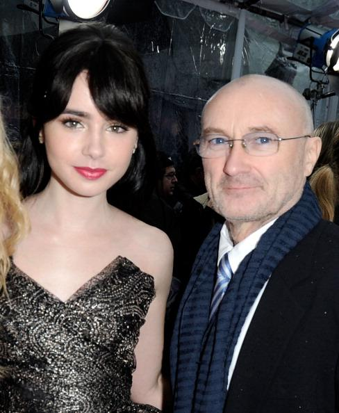 Actress Lily Collins (L) and musician Phil Collins arrive at Relativity Media's 'Mirror Mirror' Los Angeles premiere at Grauman's Chinese Theatre on March 17, 2012 in Hollywood, California. (Photo by Frazer Harrison/Getty Images For Relativity Media)