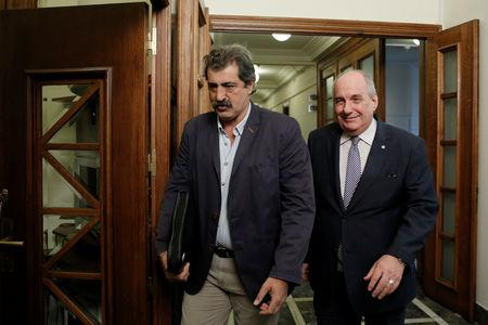 FILE PHOTO: Greek Deputy Health Minister Pavlos Polakis (L) and Greek Deputy Minister of Foreign Affairs Terens Quick arrive for a cabinet meeting at the parliament in Athens, Greece July 19, 2017.   REUTERS/Costas Baltas/File Photo