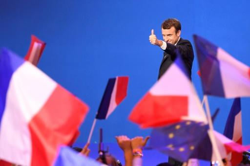 Stocks, euro surge as France's Macron favored for presidential win