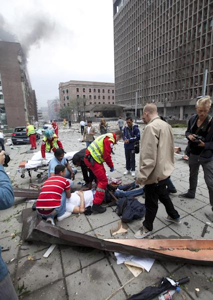 FIL:E - This is a Friday July 22, 2011 file photo of people being treated at the scene after an explosion in Oslo, A loud explosion shattered windows Friday at the government headquarters in Oslo which includes the prime minister's office, injuring several people. Anders Behring Breivik the Norwegian right-wing extremist who admitted to bomb and gun attacks that killed 77 people last year will receive his judgment Friday Aug. 24, 2012 in a court room custom built for his trial. (AP Photo/Holm Morten, Scanpix File) NORWAY OUT