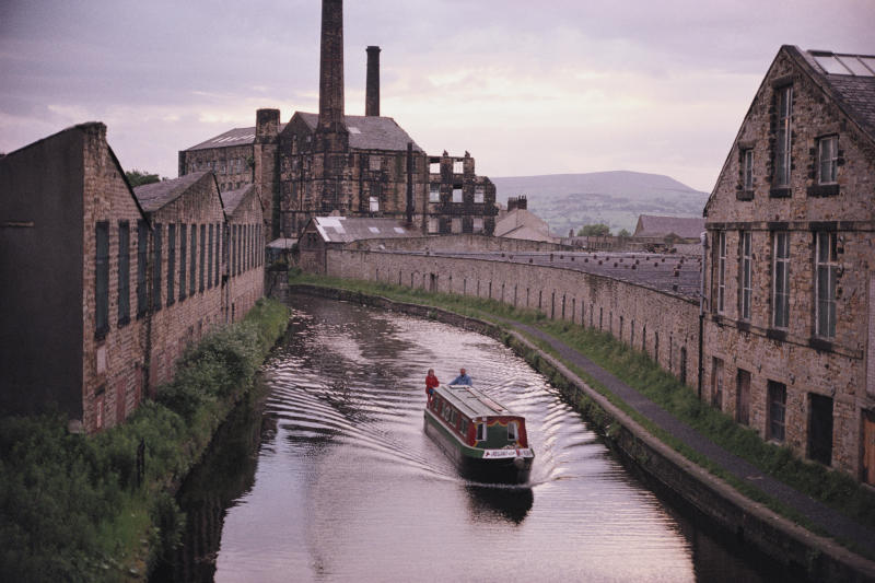A barge sails along the Leeds and Liverpool canal by Weaver's triangle. (Photo By RDImages/Epics/Getty Images)