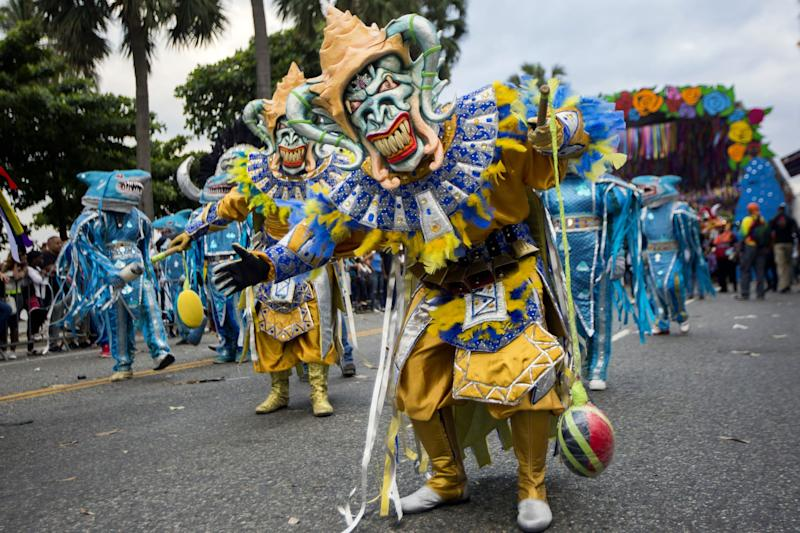 Revelers parade along the Malecon avenue in Santo Domingo during Carnival celebrations on March 4, 2018. / AFP PHOTO / Erika SANTELICES (Photo credit should read ERIKA SANTELICES/AFP via Getty Images)