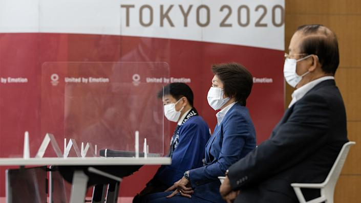 (L-R) Tokyo 2020 Games Delivery Officer Hidemasa Nakamura, Tokyo 2020 President Seiko Hashimoto and Tokyo 2020 CEO Toshiro Muto attend a meeting with IOC President Thomas Bach at the Tokyo 2020 Headquarters on July 13, 2021 in Tokyo, Japan. (Takashi Aoyama/Getty Images)