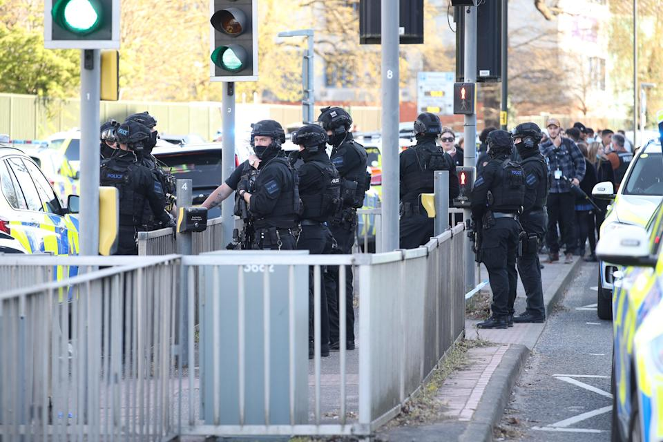 Significant numbers of armed police remained at the scene in the West Sussex townPA Wire