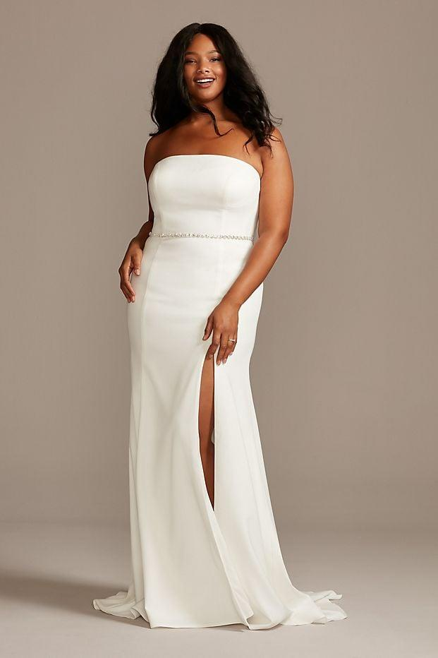 """<p>This <product href=""""https://www.davidsbridal.com/Product_strapless-button-back-plus-size-wedding-dress-9wg3995_all-wedding-dresses"""" target=""""_blank"""" class=""""ga-track"""" data-ga-category=""""Related"""" data-ga-label=""""https://www.davidsbridal.com/Product_strapless-button-back-plus-size-wedding-dress-9wg3995_all-wedding-dresses"""" data-ga-action=""""In-Line Links"""">David's Bridal Strapless Button Back Curve Wedding Dress </product> ($239, originally $399) is timeless.</p>"""