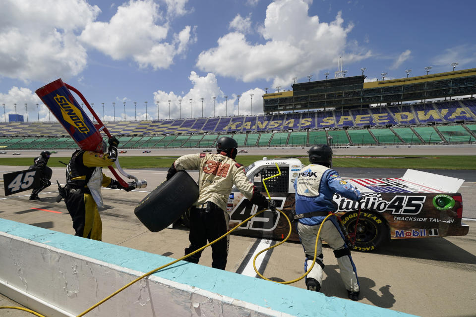 Ty Majeski (45) pits during a NASCAR Truck Series auto race at Kansas Speedway in Kansas City, Kan., Saturday, July 25, 2020. (AP Photo/Charlie Riedel)