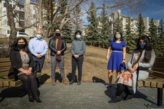 From left to right: Shamim Alavi, Mehran Imamverdi, Monir Imamverdi, Amin Imamverdi, Neda Imamverdi, and Sama Imamverdi pose for an outdoor family photo with their masks on.