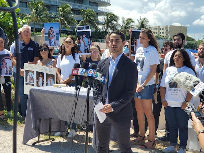 Martin Langesfeld, whose sister Nicole Langesfeld, 26, and brother-in-law Luis Sadovnic, 25, were both killed in the Champlain Towers South collapse, speaks at a press conference in Surfside, Fla. in favor of a monument to be built on the site. Sept. 23, 2021.
