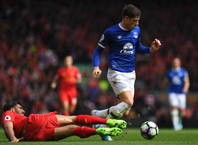Everton's midfielder Ross Barkley (R) vies with Liverpool's midfielder Emre Can during the English Premier League football match between Liverpool and Everton at Anfield in Liverpool, north west England on April 1, 2017 (AFP Photo/Paul ELLIS)