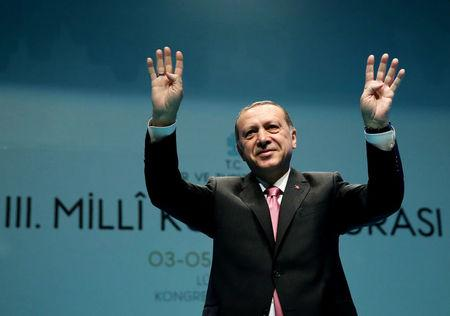 Turkish President Erdogan greets the audience during a conference in Istanbul,