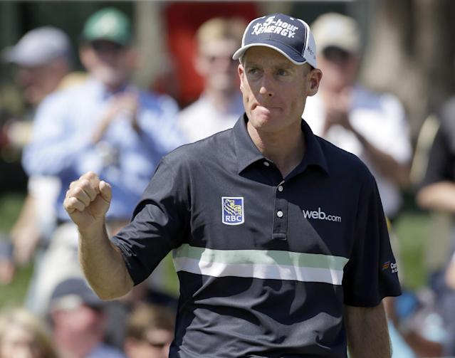 Jim Furyk reacts after chipping in for an eagle on the 15th hole during the final round of the Wells Fargo Championship golf tournament in Charlotte, N.C., Sunday, May 4, 2014. (AP Photo/Bob Leverone)