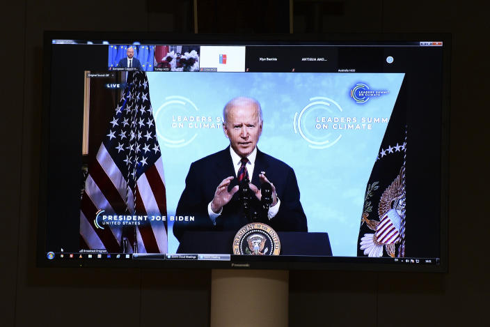 FILE - In this April 22, 2021 file photo, U.S. President Joe Biden is seen on a screen as European Council President Charles Michel attends a virtual Global Climate Summit via video link from the European Council building in Brussels. On Biden's first foreign trip as president, he will find many of his hosts in Europe welcoming but wary after a tense four years between Europe and the U.S. under former President Donald Trump. (Johanna Geron/Pool Photo via AP, File)
