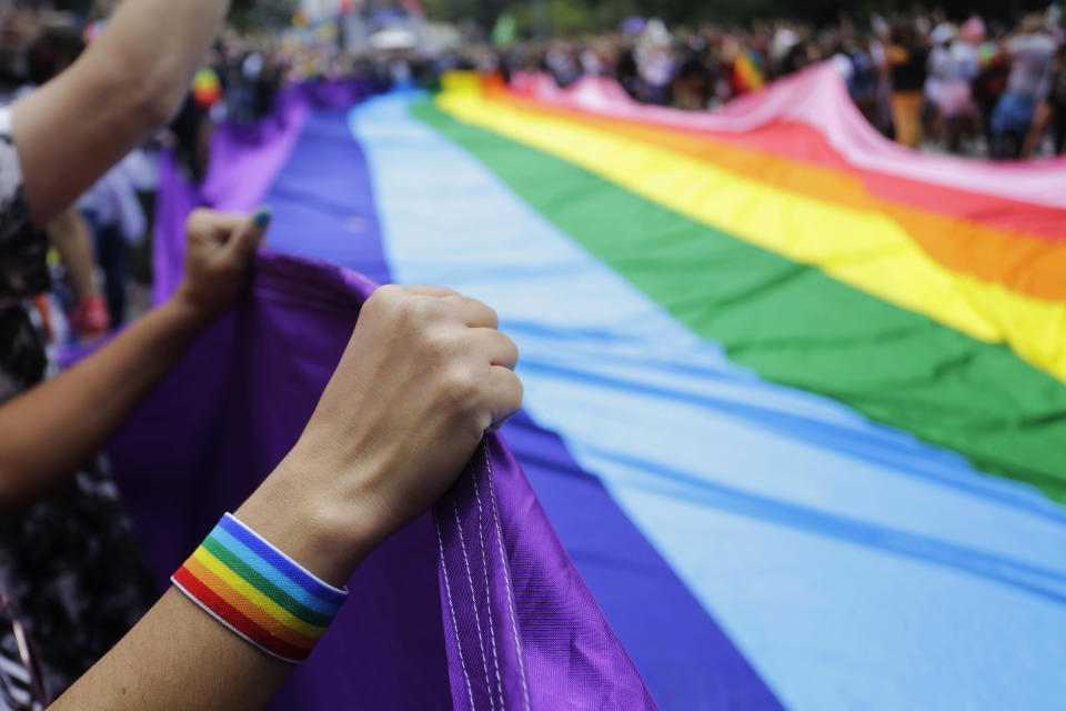 The NFL and MLB will participate in the New York City Pride March for the first time later this month, joining the NBA, WNBA, NHL and multiple other professional sports leagues in the event. (AP Photo/Nelson Antoine)