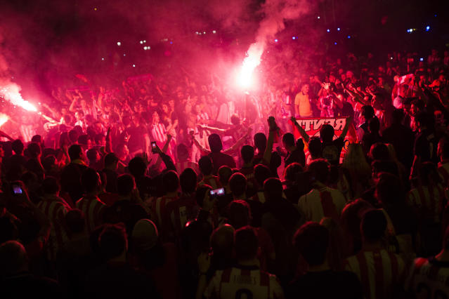 Atletico Madrid supporters light flares as they celebrate their team's Europa League tittle in Madrid, early Thursday, May 17, 2018. Atletico defeated Marseille 3-0 in the final and clinches its third Europa League title. (AP Photo/Francisco Seco)
