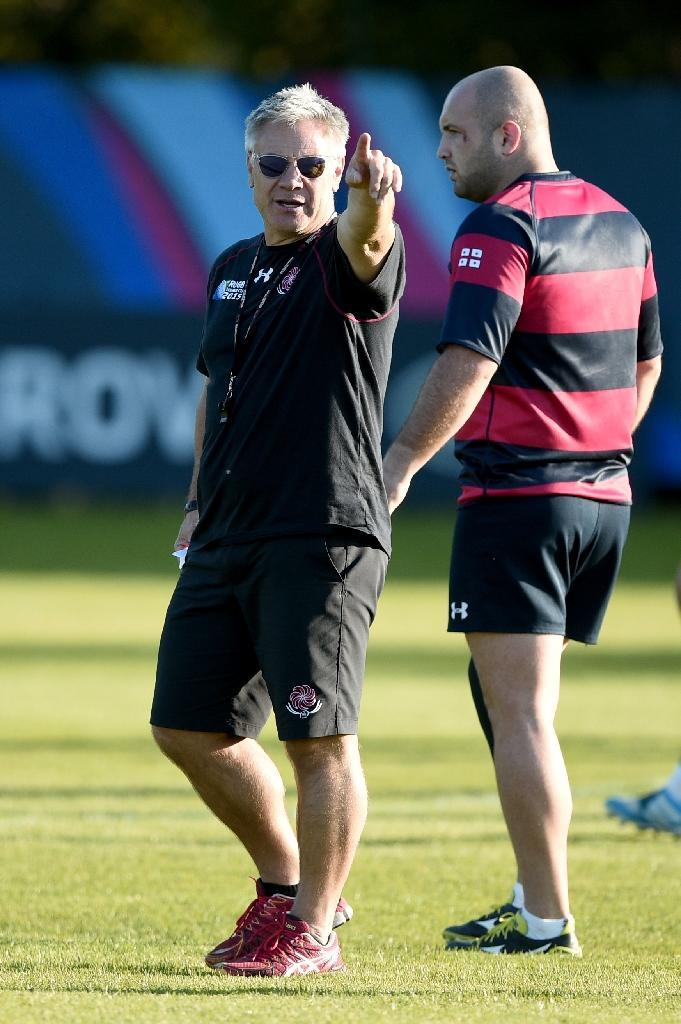 Georgia's head coach Milton Haig (L) gestures during a team training session at Newport High School in south Wales, on September 28, 2015, during the Rugby World Cup (AFP Photo/Damien Meyer)