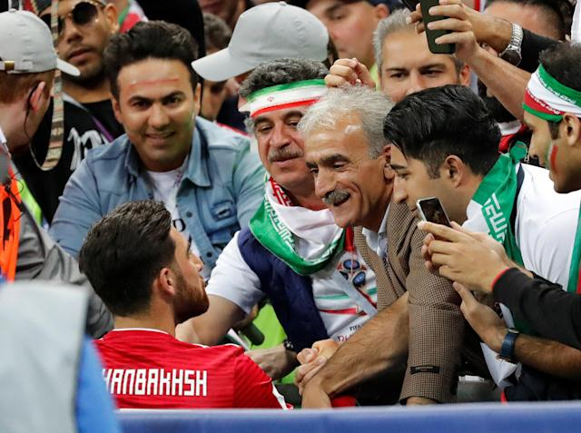 Soccer Football - World Cup - Group B - Iran vs Spain - Kazan Arena, Kazan, Russia - June 20, 2018 Iran's Alireza Jahanbakhsh talks with fans after the match REUTERS/Toru Hanai