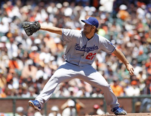 Los Angeles Dodgers pitcher Clayton Kershaw throws to the San Francisco Giants during the first inning of a baseball game in San Francisco, Sunday, July 7, 2013. (AP Photo/George Nikitin)